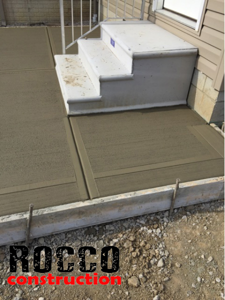 Rocco Construction: Concrete Patio Frame Out Of Concrete Patio With Rock  Bedding And Lined Designed Edge.